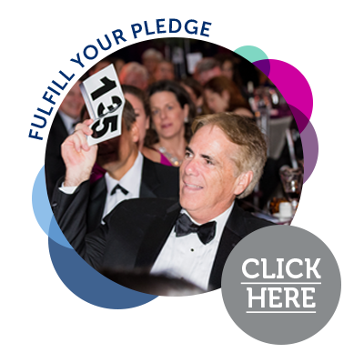 man holding up number fulfill your pledge click here