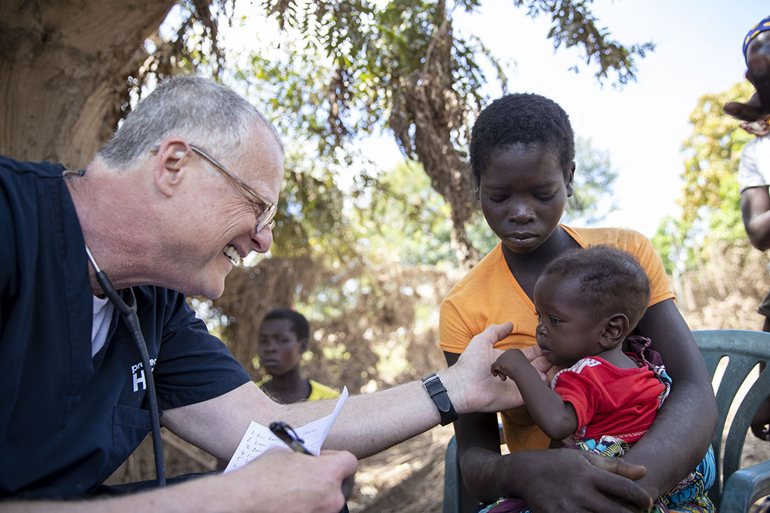 Medical volunteer examining a young patient in Beira, Mozambique.