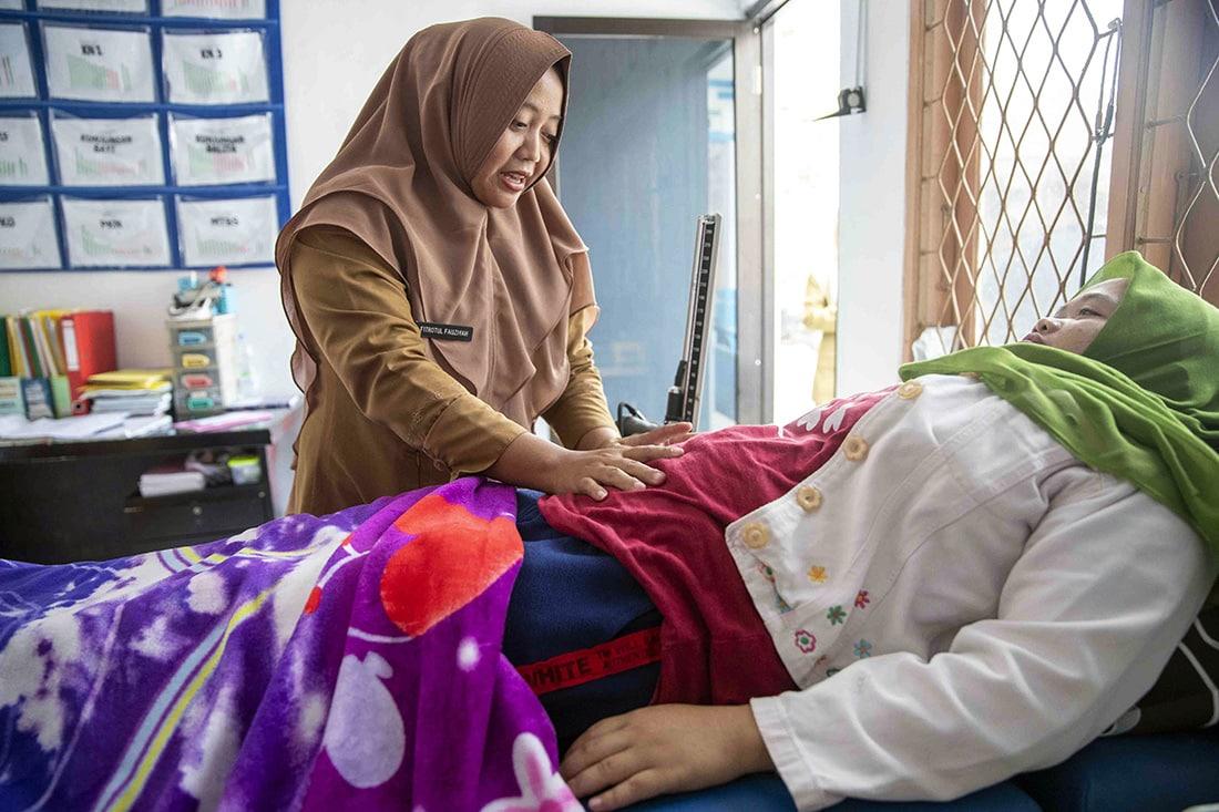 Mother receiving prenatal care in Indonesia