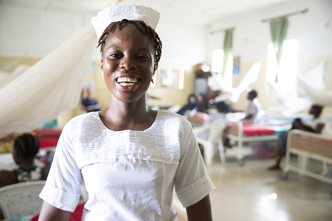 Nurse in a medical unit smiling at the camera